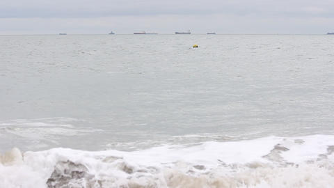Waves with Tankers in the Distance Footage