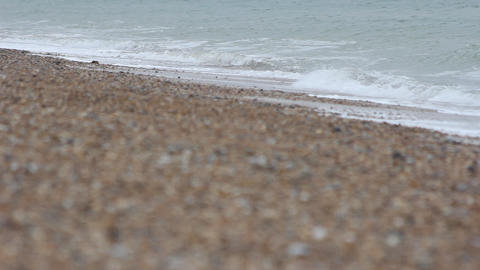 Waves Crashing onto Shingle Beach Footage