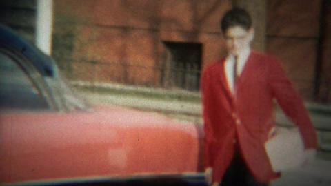 1964: Proud teenage boy red jacket carry white package box Footage