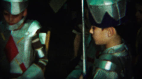 1964: Young soldier knights boy tapping shoulder fake sword blade Footage