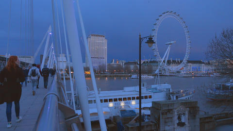Golden Jubilee Bridge and London Eye in the evening Live Action