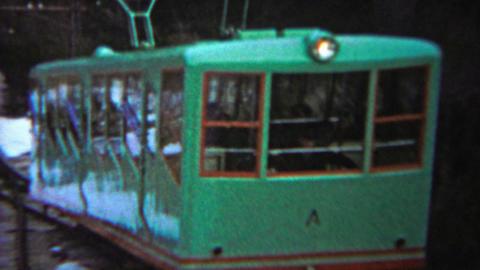 1956: Green Passenger Tram People Moving Train Uphill Winter Snow stock footage
