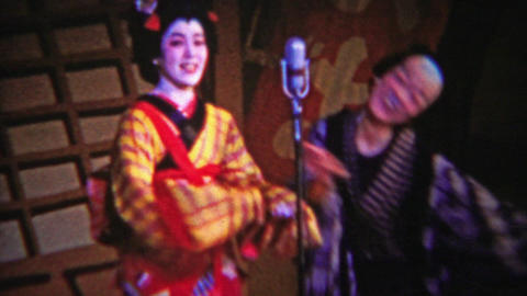 1956: Japanese comedy show funny geisha man dancing silly Footage