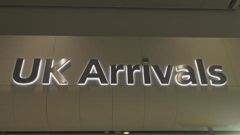 UK Arrivals sign at London Heathrow Airport Live Action