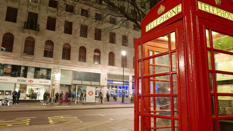4k - Time lapse shot of British telephone booth and street traffic Hyper lapse  Footage