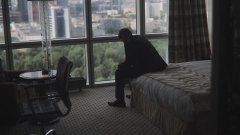 Man In Elegant Suit Sitting On A Bed stock footage