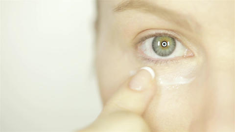 Woman Applying Skin Cream Under Eyes Footage