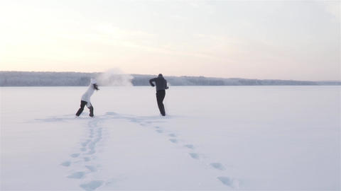 Young Joyful Happy Couple In Winter Day Footage
