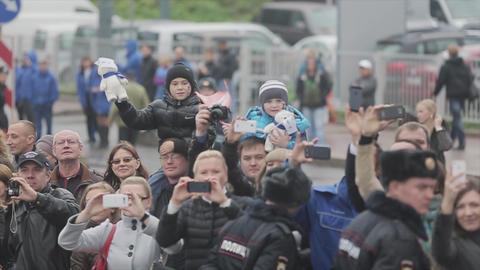 SAINT PETERSBURG, RUSSIA - OCTOBER 27, 2013: Many people smile. Kids wave Footage