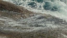Close Up Of Waves Crashing on Rocks Footage