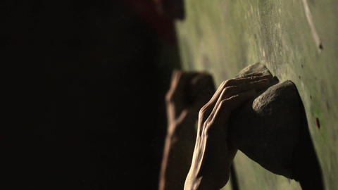 Close-up of a climbing wall, hand grasping a stone. Slow motion Footage