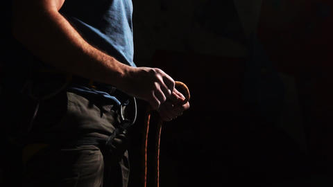 Close-up of an athlete's hand that ties a rope climber to climb a mountain on a Footage