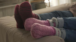Close-up of female legs in woolen socks, coziness, care, kindness, warmth Footage