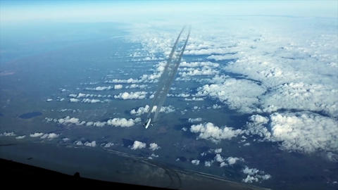 Airplain contrail going through the cloudness sky Footage