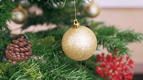 Twisted golden ball on Christmas tree Footage