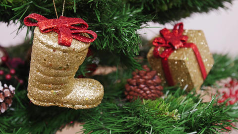 Decoration of Christmas tree golden boot Footage
