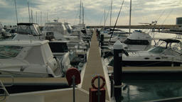 Looking Down a Walkway Between Boats Moored in a Marina in Perth Footage