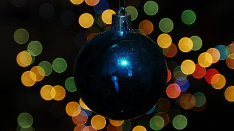 Christmas ball at background of blurred lights Footage