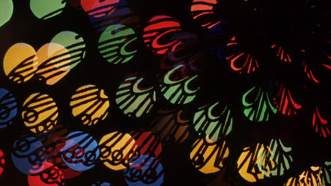 Butterfly lights bokeh on black background. Shape Footage