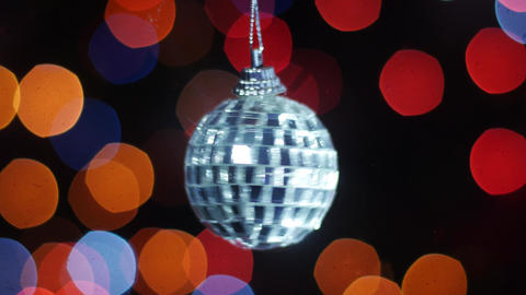 Mirror ball rotates at background of bokeh lights ビデオ