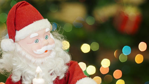 Toy Santa Claus moves at background bokeh lights Footage
