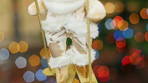 Santa Claus on skis at background bokeh. Pan Footage