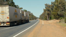 Long Road Train Travelling Down An Australian Highway Footage