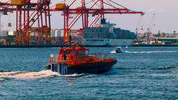 Pilot Boat Coming Into Port With Docks In The Background Footage