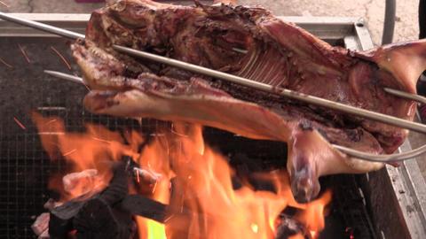 barbecuing crispy piglet Live Action