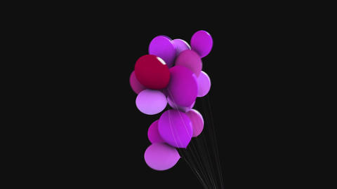 Colored balloons on a black background Footage