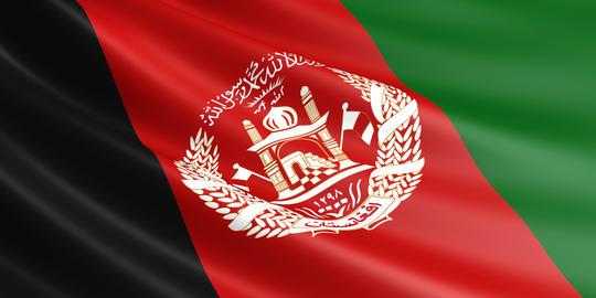 Afghan flag fluttering in wind Photo