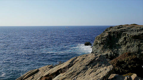 sea coast with rocks, blue sky, sea waves. beautiful majestic landscape Footage