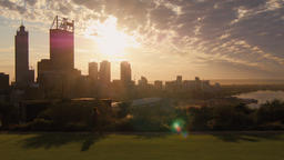 People Exercising In King's Park As The Sun Rises Over Perth City 영상물