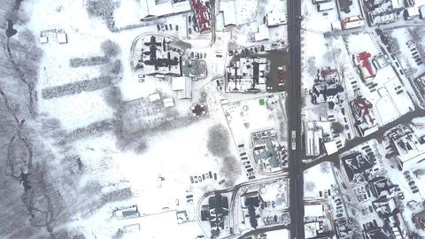 Aerial top down view of a typical Eastern European town in the snow Footage