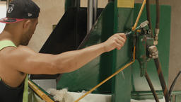 Man Pressing Freshly Shorn Wool in a Woolpress Footage