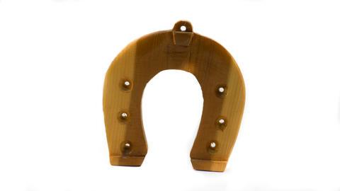 Wooden horseshoe isolated on white background Photo