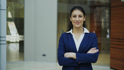 Portrait of successful businesswoman smiling and looking into camera in modern Footage