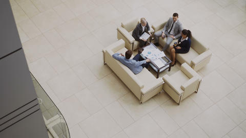 Top view of group of business people colleagues discussing financial charts Footage