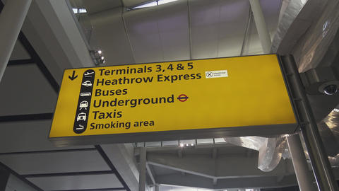 Direction sign to terminals at London Heathrow Airport Footage