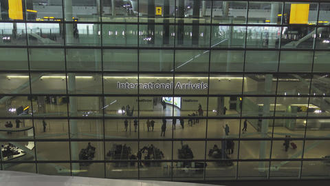 International Arrivals at London Heathrow Airport Live Action