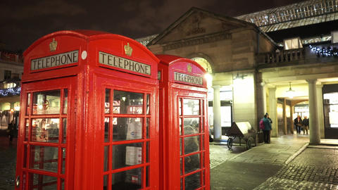 Red Telephone Booth at Covent Garden London by night - LONDON, ENGLAND NOVEMBER  Footage