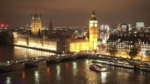 Houses of Parliament Westminster Bridge and Big Ben aerial view by night - LONDO Live Action