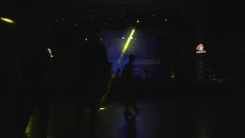 Warming up for electronic music party in a hall with a DJ Footage