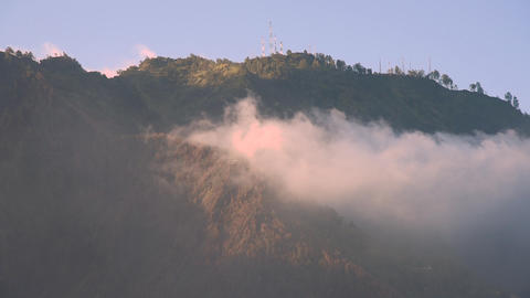 Mist flowing through trees and mountain near Mount Bromo, Indonesia Footage