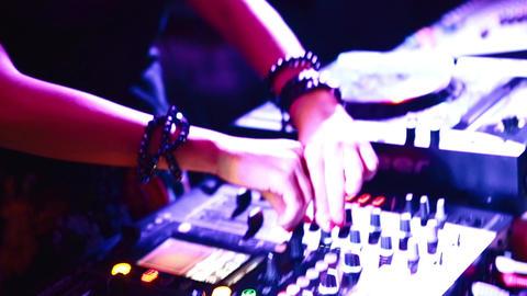 SAINT PETERSBURG, RUSSIA - JUNE 10, 2015: Attractive female DJ at DJ panel Live Action