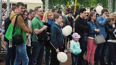 SAINT PETERSBURG, RUSSIA - SEPTEMBER 6, 2014: In love couple stay among crowd Footage