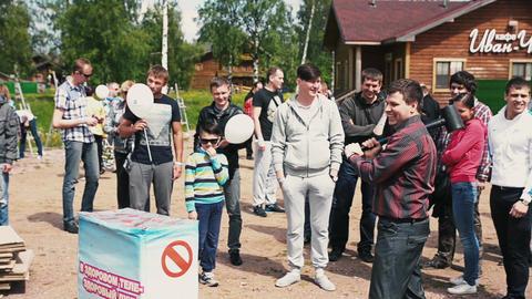 SAINT PETERSBURG, RUSSIA - SEPTEMBER 6, 2014: Young man weakly bump on sensitive Footage
