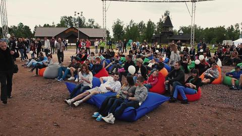 SAINT PETERSBURG, RUSSIA - SEPTEMBER 6, 2014: People lie on huge beanbags on Footage