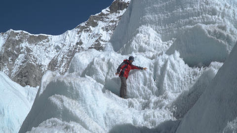 The girl climbs the glacier Footage
