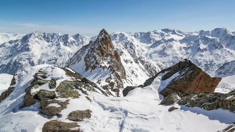 Beautiful Sunny Winter Day in Snowy Alps Mountains.Time Lapse Dolly Shot over Footage